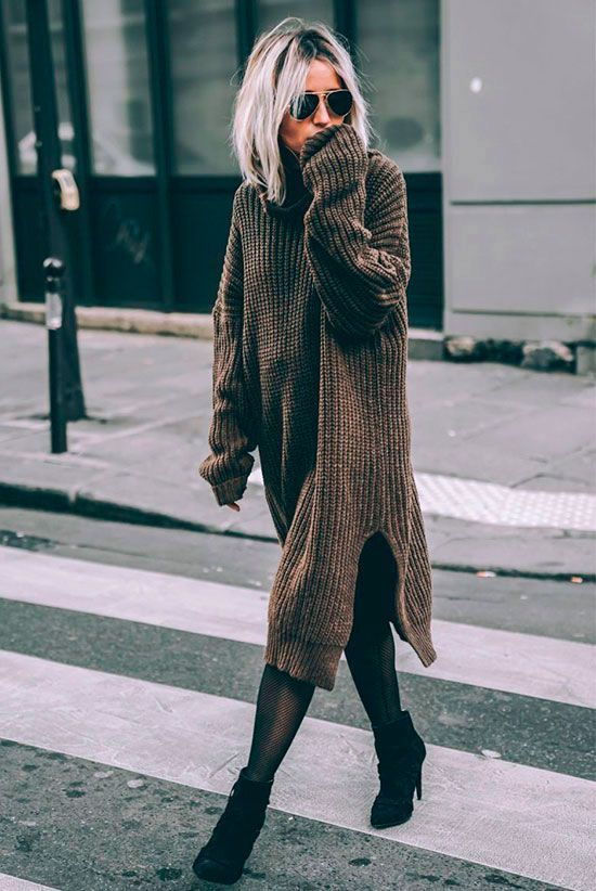 a taupe sweater dress, black booties and black tights to keep you warm all the time