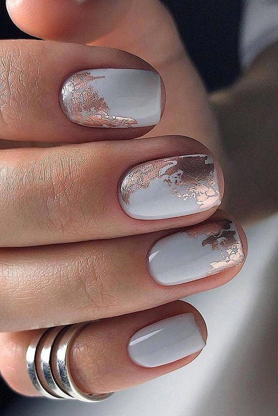 a white manicure with copper foil is a very chic and unusual idea to try