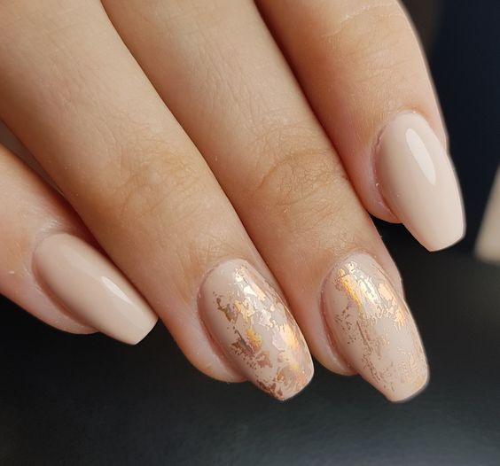 14 a nude manicure with gold foil touches is a beautiful and romantic idea for every girl