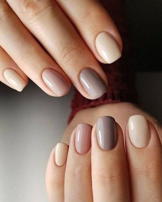 a very pretty nude and muted color manicure in a monochromatic color palette is all chic