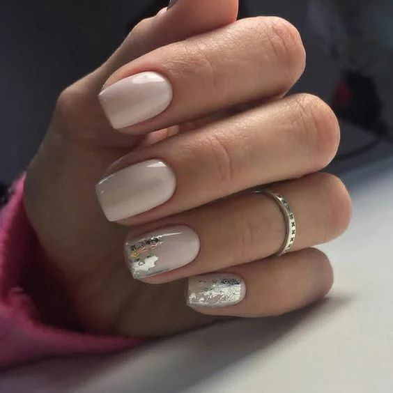 a nude manicure with silver leaf is a stylish and elegant idea to rock for holidays