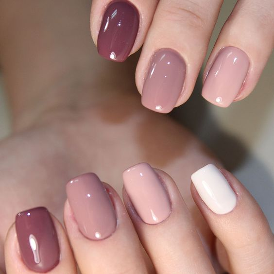 16 a stylish monochromatic manicure from mauve to white is very feminine