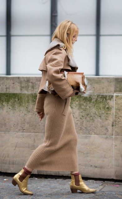 With beige maxi skirt, beige jacket and clutch