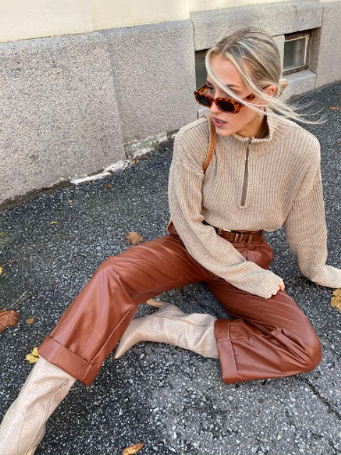 With beige sweater, brown bag and beige high boots