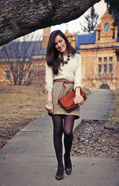 With beige sweater, brown clutch and low heeled shoes