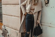 With beige sweater, distressed jeans, black bag and beige midi coat