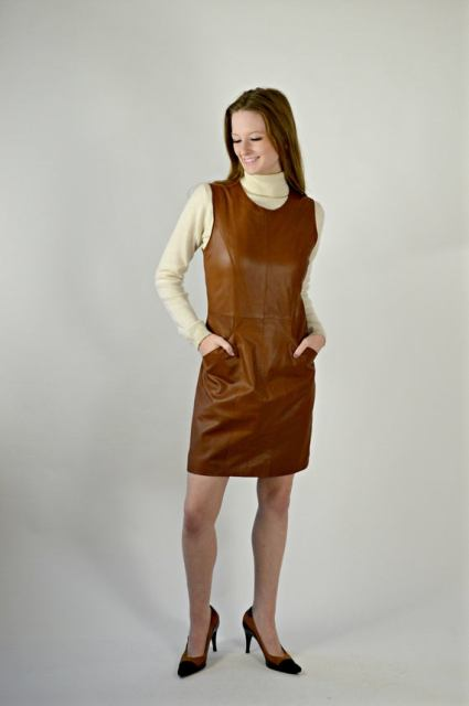 With beige turtleneck and black and brown pumps