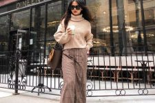 With beige turtleneck sweater, brown bag and boots