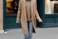 With beige turtleneck sweater, loose jeans and beige coat
