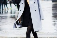 With black dress and pastel colored coat