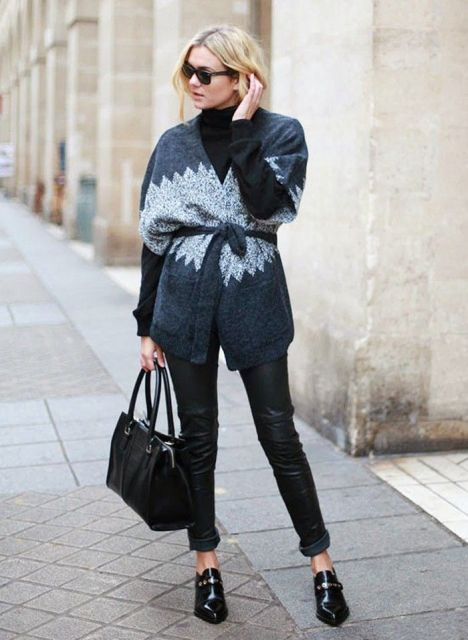 With black leather cuffed pants, black leather bag and embellished shoes