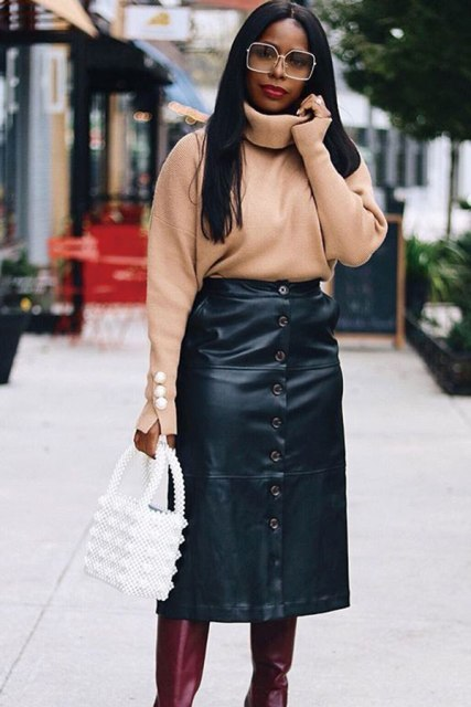 With black leather midi skirt, white bag and marsala high boots