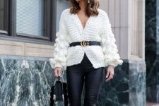 With black leather skinny pants, black bag and leopard printed pumps