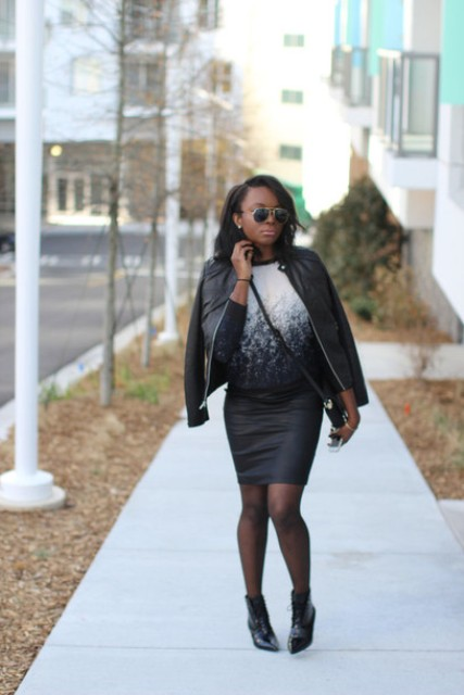With black leather skirt, black leather jacket and lace up boots
