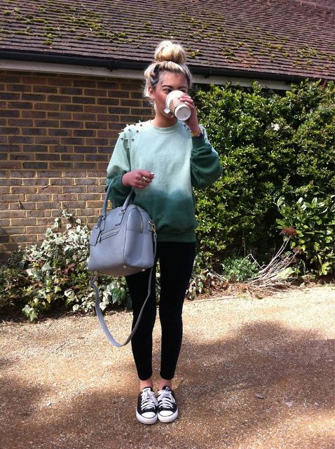 With black leggings, gray bag and sneakers