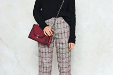 With black loose sweater, marsala chain strap bag, cap and white sneakers