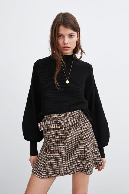 With black loose sweater