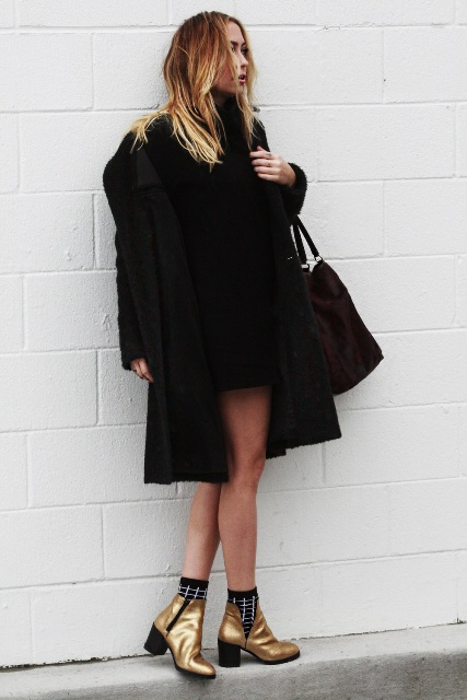 With black mini sweater dress, brown bag and black coat