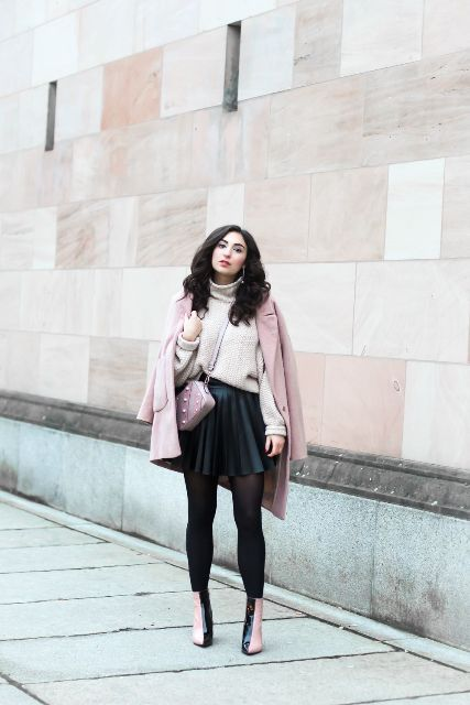 With black pleated mini skirt, pale pink coat, crossbody bag and black and pale pink ankle boots