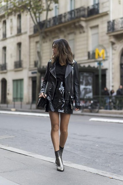 With black shirt, black leather jacket, bag and black patent leather mini skirt