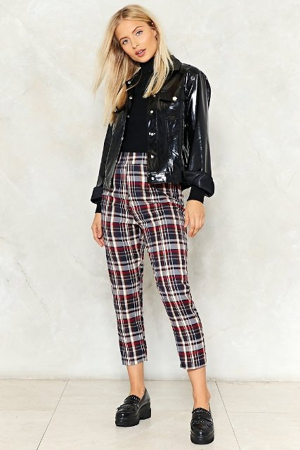 With black shirt, black patent leather jacket and black shoes