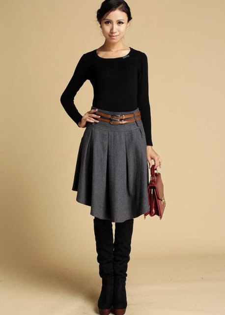 With black shirt, brown leather bag and over the knee boots