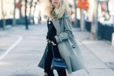 With black shirt, distressed pants, gray coat and chain strap bag