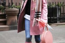 With black sweater, white shirt, skinny jeans, pale pink coat and rounded bag
