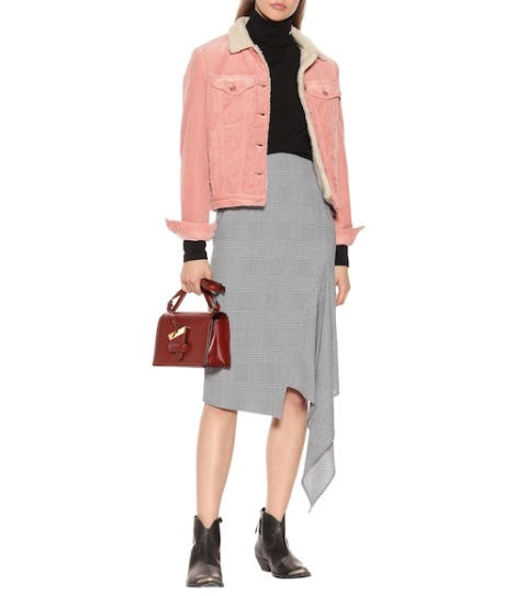With black turtleneck, asymmetrical skirt, marsala bag and low heeled boots