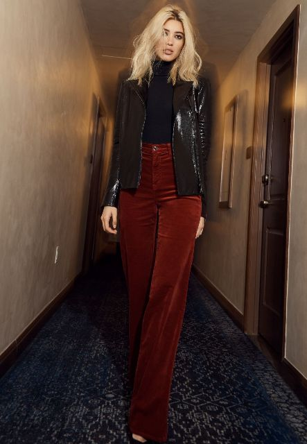 With black turtleneck, black patent leather blazer and shoes