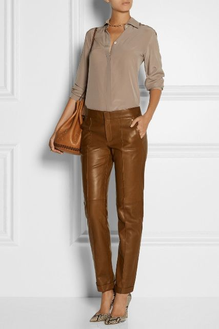 With blouse, brown leather bag and printed pumps