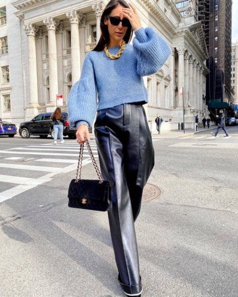 With blue cropped sweater, chain strap bag and boots