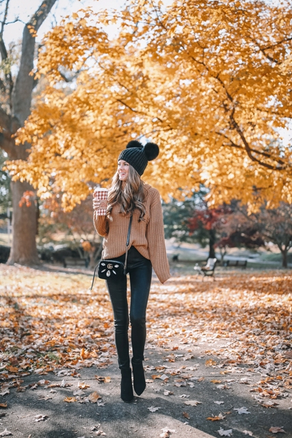 With brown loose sweater, skinny trousers, black ankle boots and embellished bag