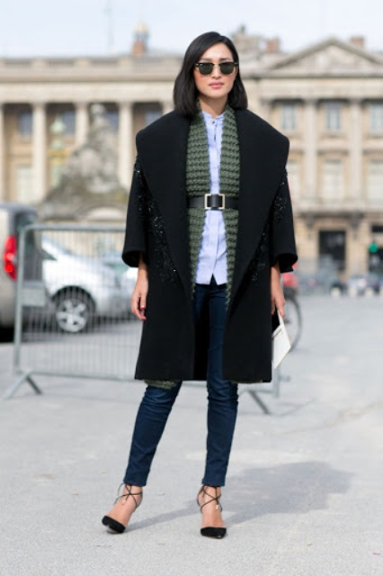 With button down shirt, black coat, skinny jeans and lace up shoes
