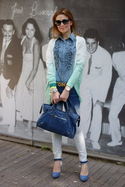 With denim ruffled shirt, ombre pants, blue shoes and blue leather bag