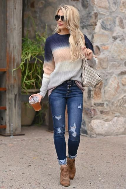 With distressed jeans, printed bag and brown ankle boots