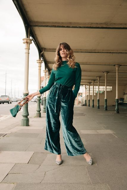 With emerald shirt, emerald bag and embellished shoes