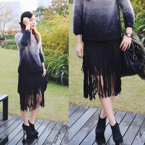 With fringe skirt, black bag and black ankle boots