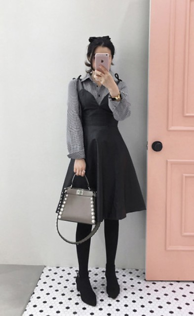 With gray shirt, gray embellished bag and black low heeled boots