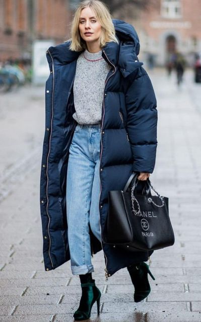 With gray sweater, cuffed jeans, black tote bag and emerald velvet ankle boots
