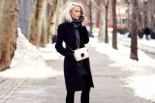 With gray sweater dress, black coat and white chain strap bag