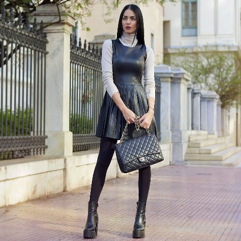 With gray turtleneck, chain strap bag and platform boots