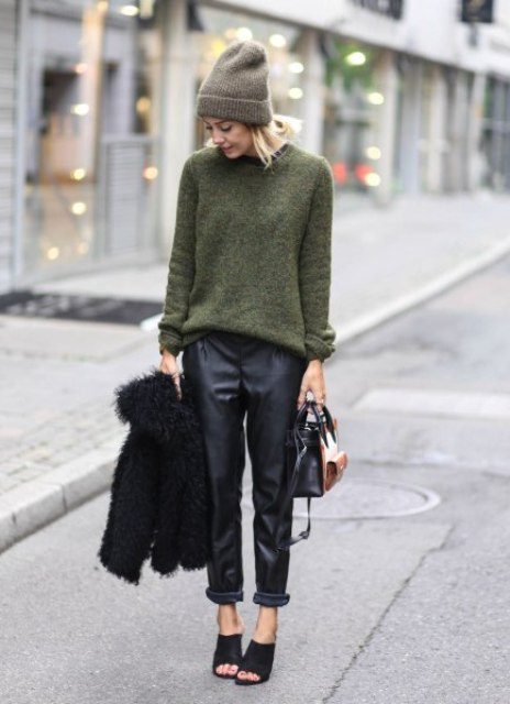 With green sweater, hat, black fur jacket, black mules and brown and black bag