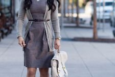 With knee-length dress, white bag and beige pumps