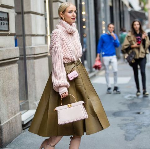 With leather midi skirt and pale pink bag