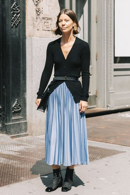 With light blue pleated midi skirt, black clutch and low heeled ankle boots