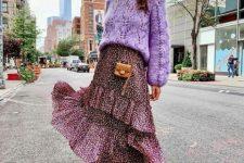 With lilac sweater, printed ruffled midi skirt and mini bag
