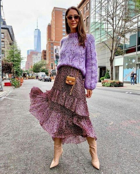 With lilac sweater, printed ruffled midi skirt and mini bag