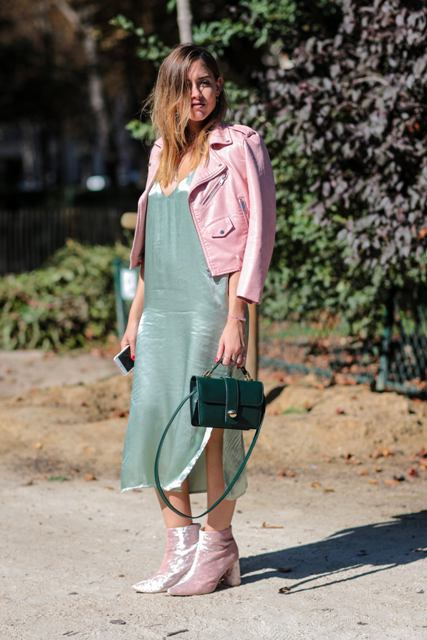 With mint green midi dress, emerald bag and pale pink leather jacket