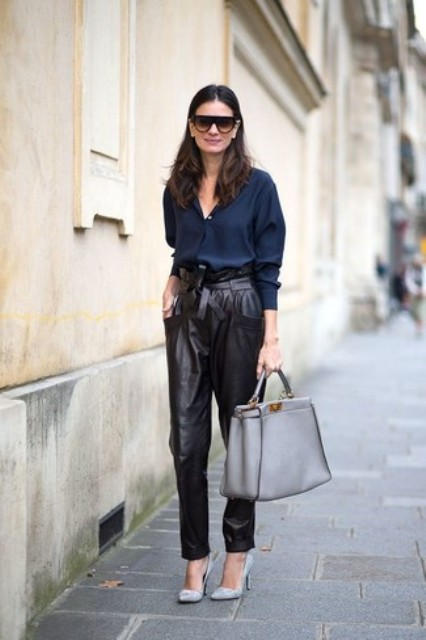 With navy blue button down shirt, gray leather tote bag and gray high heels